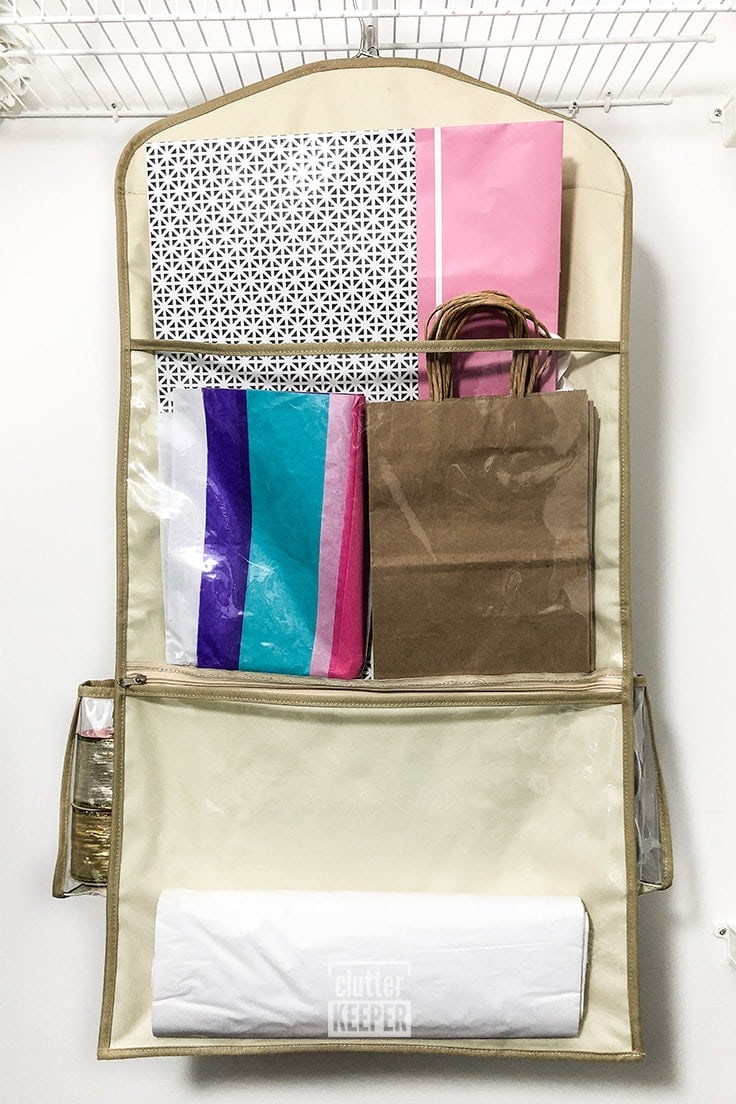Organize more gift wrap than ever before with the extra wide Deluxe Hanging Gift Wrap Storage Organizer from Clutter Keeper. The Smart Pocket System allows you to store large gift bags, tissue paper and more gift wrap supplies.