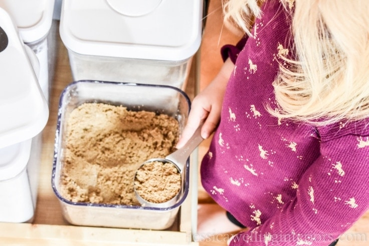 image of girl scooping brown sugar and organized baking supplies