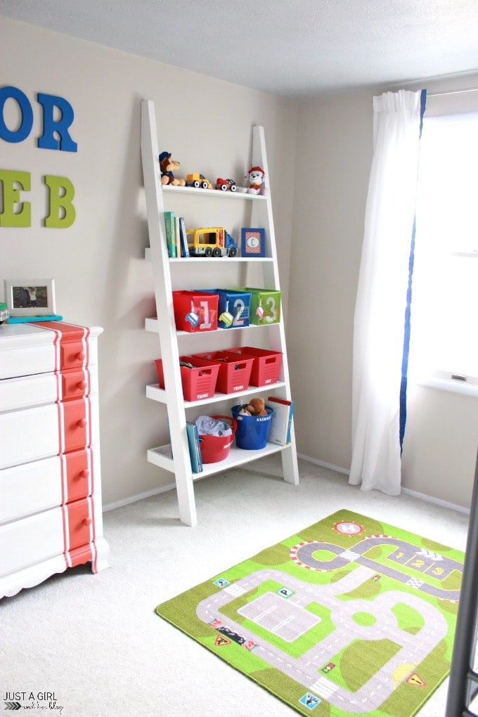 Ladder Toy Storage in a boy's room from Just A Girl and Her Blog