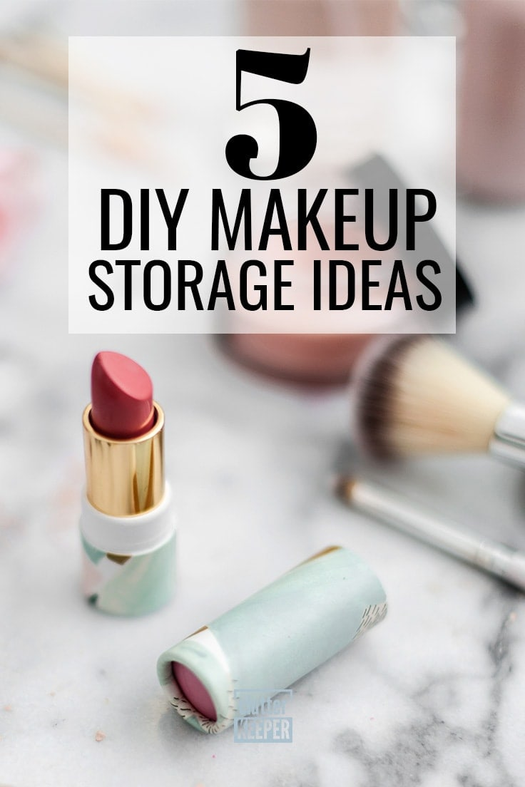 5 DIY makeup storage ideas - tube of red lipstick on a marble counter top in a bathroom