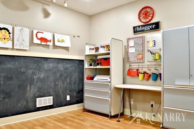 An organized craft room with tidy shelves.