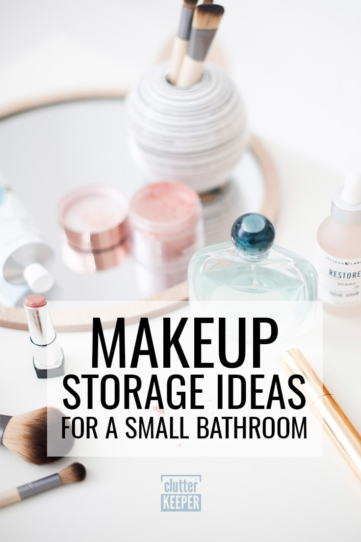 Makeup storage ideas for a small bathroom - Lipstick, makeup brushes, perfume jar, blush and mascara sitting on a circle shaped mirror on a bathroom counter