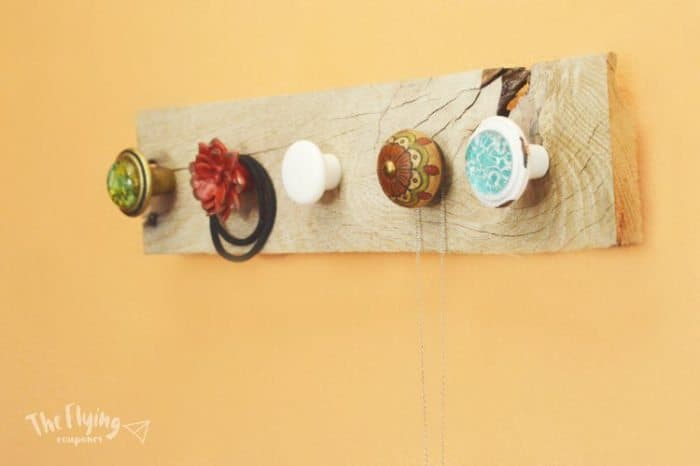 create a rustic jewelry organizer out of old knobs