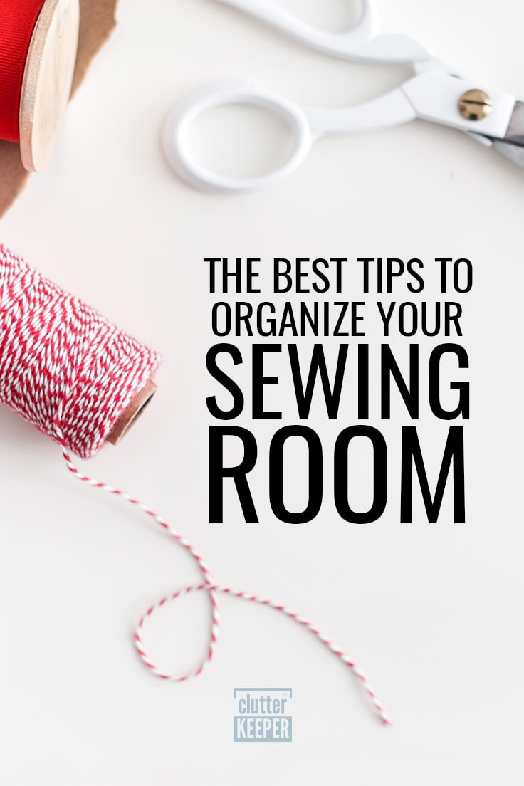 Title on Image: The Best Tips to Organize Your Sewing Room. Image shows a spool of red and white baker's twine, a pair of scissors with a white handle and the edge of a spool of red ribbon for craft and sewing projects.