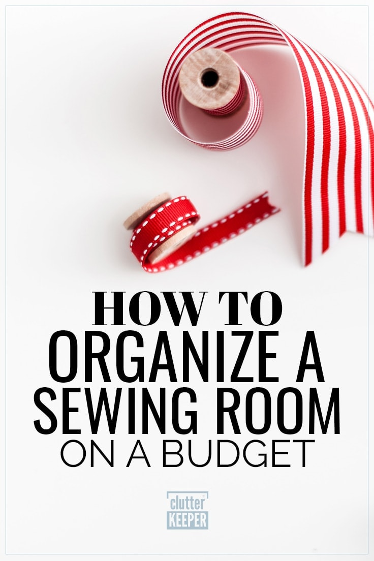 Title on Graphic: How to Organize a Sewing Room on a Budget. Image shows a spool of red ribbon and a spool of wide white and red striped ribbon for craft and sewing projects.