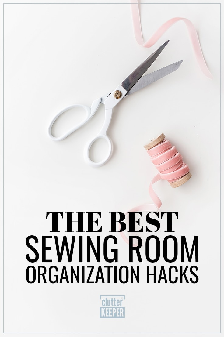 Title on Image: The Best Sewing Room Organization Hacks. The image shows a spool of ribbon and a pair of sewing scissors with white handle.