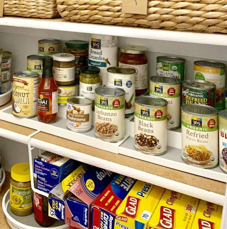 Canned foods organized in a pantry.
