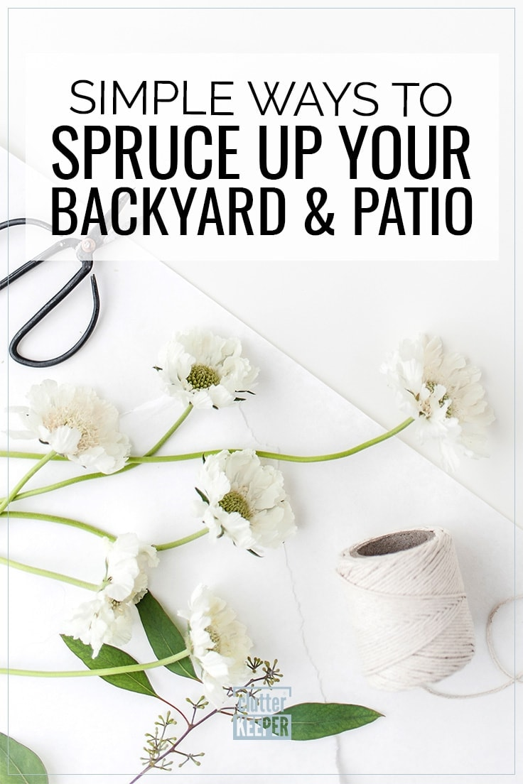 Simple Ways to Spruce Up Your Backyard and Patio; Overhead shot of an open pair of metal gardening sheers and a spool of gardening twine along with white fresh flowers that were recently cut from the backyard.
