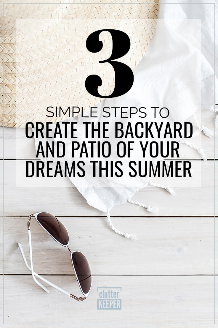 3 Simple Steps to Create the Backyard and Patio of Your Dream this Summer; overhead shot of sunglasses, a straw hat and a white linen swimsuit cover up laying on a white washed deck in a backyard.