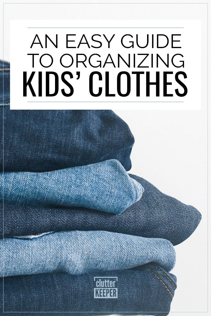 An Easy Guide to Organizing Kids Clothes - 5 pairs of kids' sized jeans folded neatly in a stack on top of a white stool. The neat pile demonstrates the importance of organizing kids clothes.