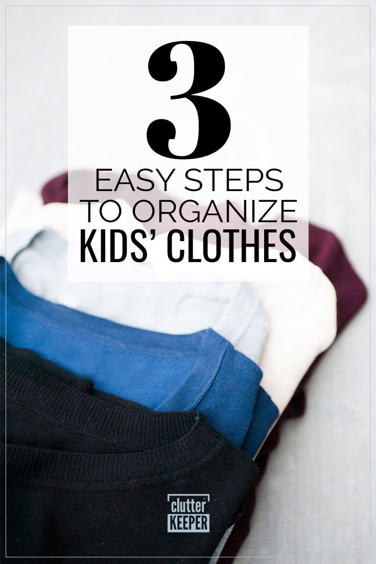 3 Easy Steps to Organize Kids' Clothes - Five crew neck children's t-shirts, neatly folded and laying in a diagonal row slightly overlapping one another to show how to organize kids' clothes.