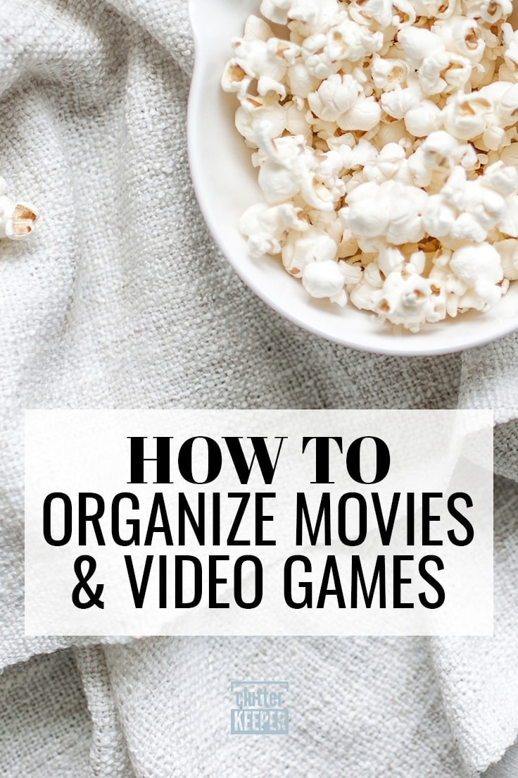 How to Organize Movies and Video Games - a partial bowl filled with popcorn sitting on a blanket on a couch.