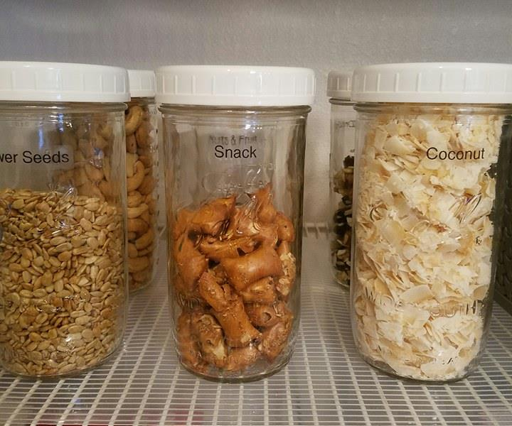 Organized food in a pantry.