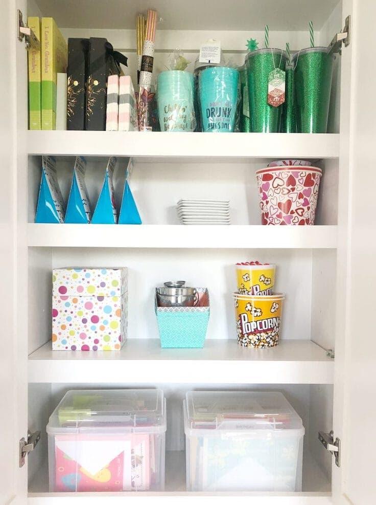 An organized craft room closet shelf.