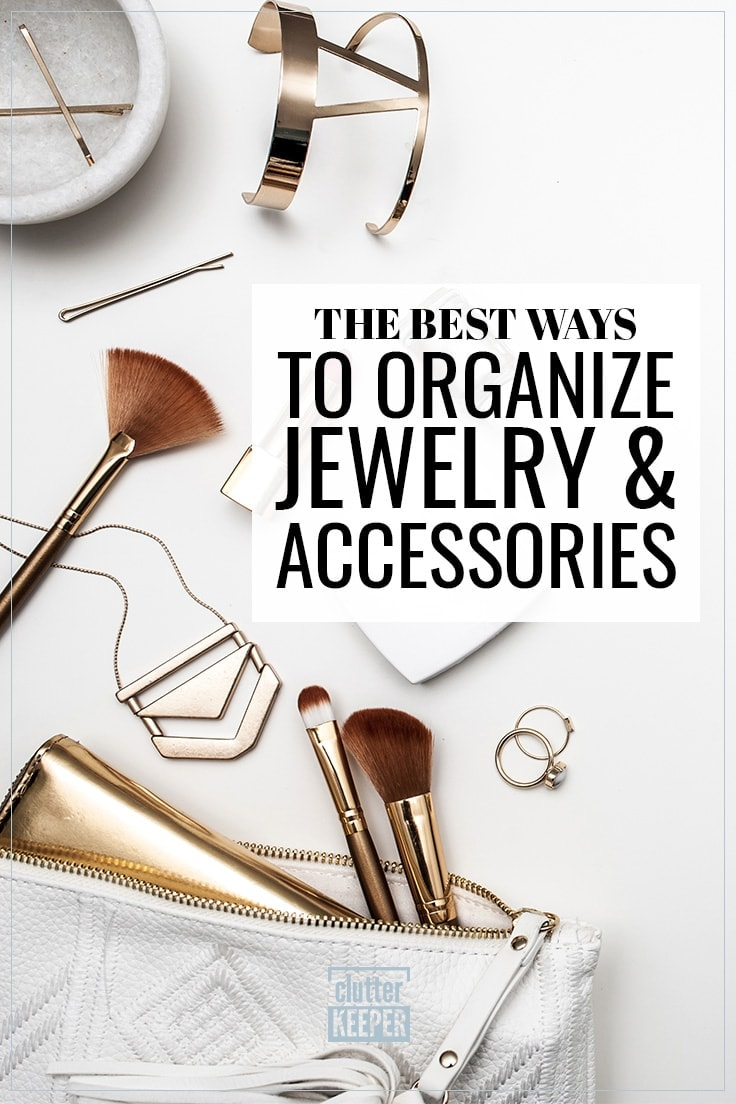 The best ways to organize jewelry and accessories, an overhead view of a white leather purse. The zipper is open at the top and the contents are spilling out including make-up brushes, necklaces, rings, a bracelet and other jewelry.