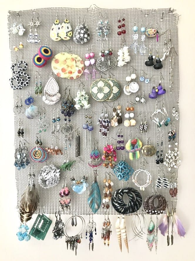 Hanging earrings on the wall can save space on the countertop