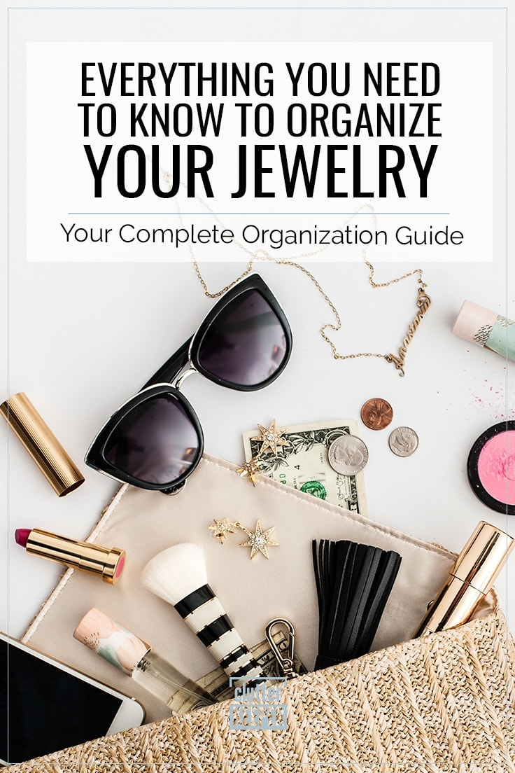 Everything you need to know to organize your jewelry. Your complete organization guide. Trendy straw clutch purse open at the top with it's contents spilling out including make-up money, a cell phone, earrings, jewelry, sunglasses and other accessories.