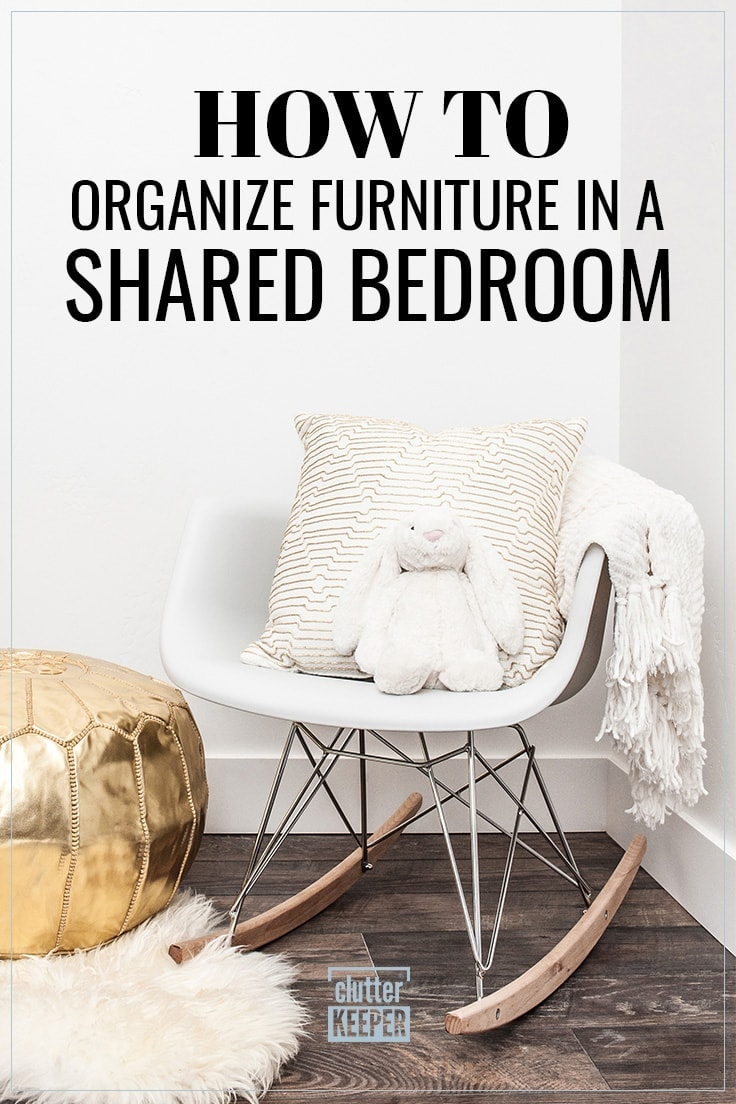 How to Organize Furniture in a Shared Bedroom, a modern rocker with a throw pillow, blanket and a stuffed bunny in a bedroom shared by two or more children