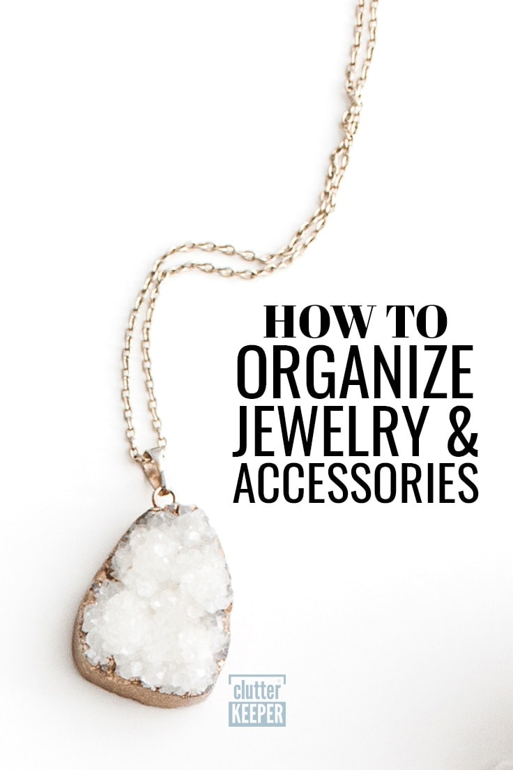 How to Organize Jewelry and Accessories. A close-up of a gold necklace with a large crystal pendant.