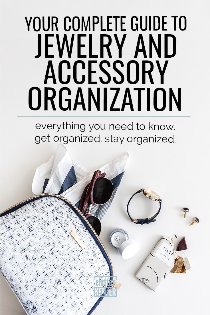 Your Complete Guide to Jewelry and Accessory Organization. Everything You Need to Know. Get Organized. Stay Organized. Blue and white small tweed bag on its side with accessories and contents spilling out, including a scarf, sunglasses, wrist watch, earrings and a partially eaten chocolate bar