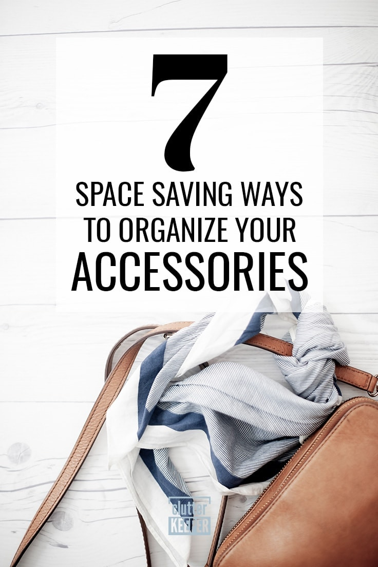 7 Space Saving ways to organize your accessories, an overhead view of a brown leather purse laying on its side with a blue and white striped scarf tied around the purse strap.