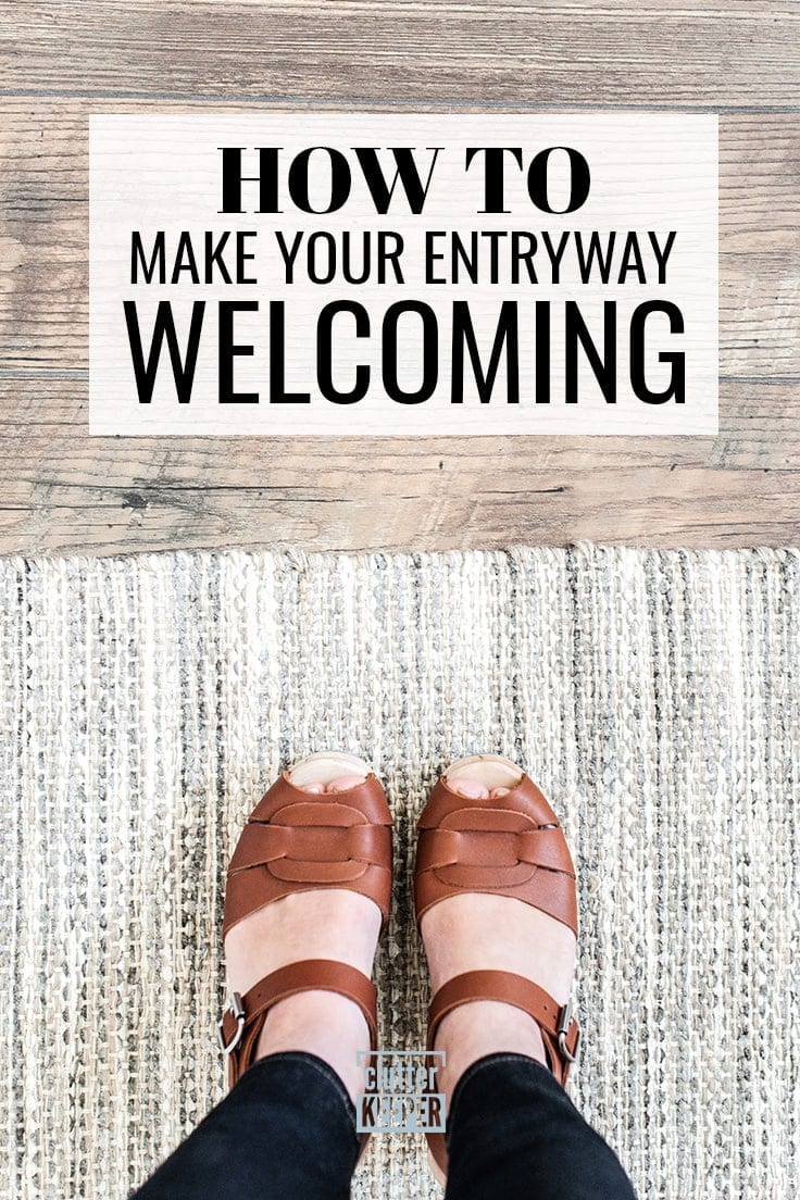 How to Make Your Entryway Welcoming, Close up of the feet of a woman wearing brown leather sandals, standing on a woven rug in a mudroom.
