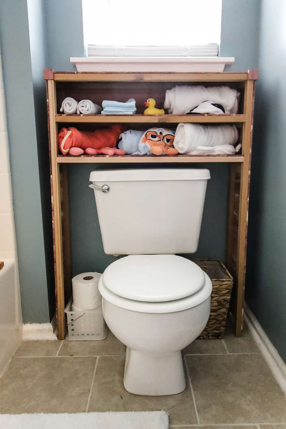 DIY cedar shelves for the over the toilet storage.