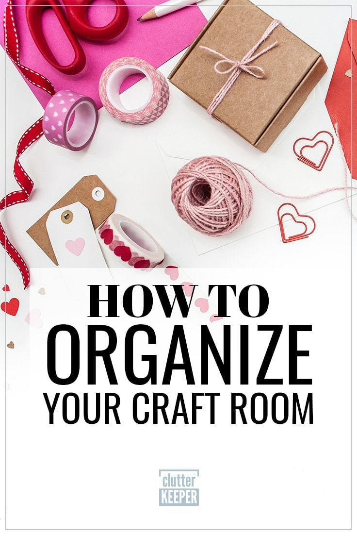 How to Organize Your Craft Room, organized craft supplies on a table top including washi tape, ribbons, scissors, string, tags and a pencil.