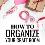 How to Organize Your Craft Room, organized craft supplies on a table top including washi tape, ribbons, scissors, string, tags and paper clips