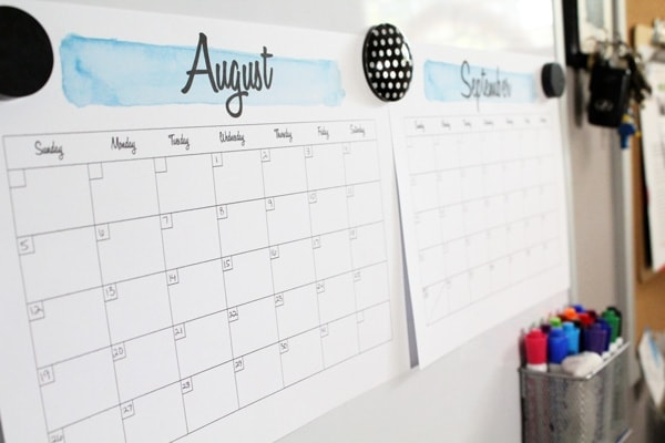 A family command center with August and September calendars