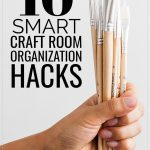 10 Smart Craft Room Organization Hacks, a hand holding a bunch of paint brushes