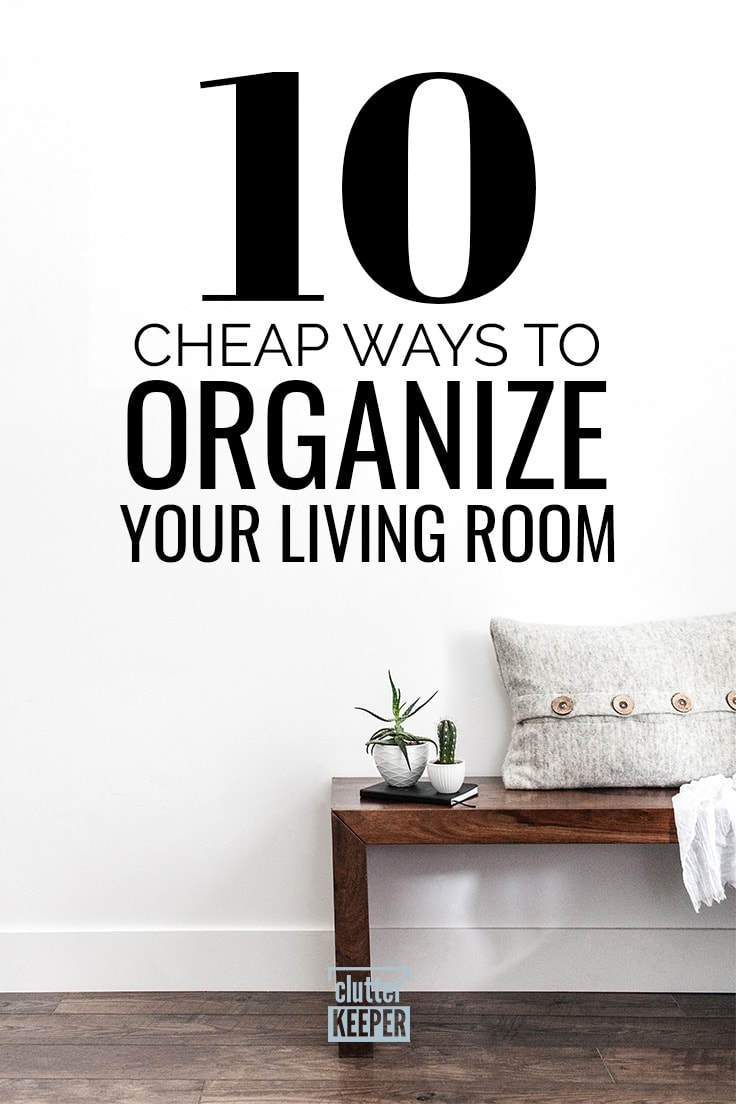 10 Cheap Ways to Organize Your Living Room, a wooden console table with two small planters, a notebook and a throw pillow