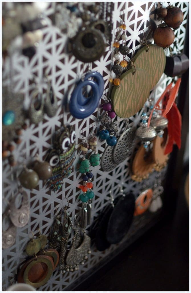 A close-up of a DIY earring holder.