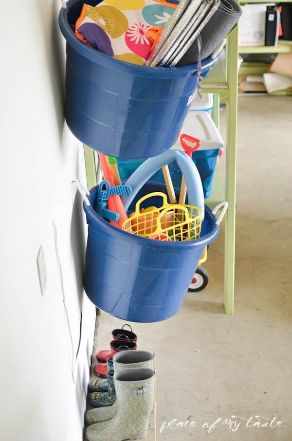 Hang buckets on the wall of the garage to keep it organized