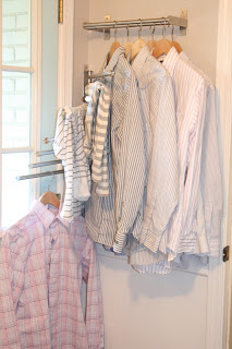Use IKEA racks to hang up clothes in a small room.