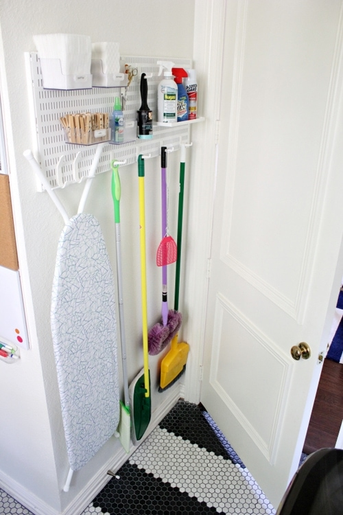 Behind the door storage in a laundry room