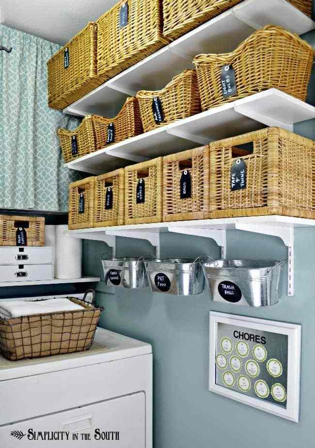 An organized laundry room with baskets and buckets on the wall