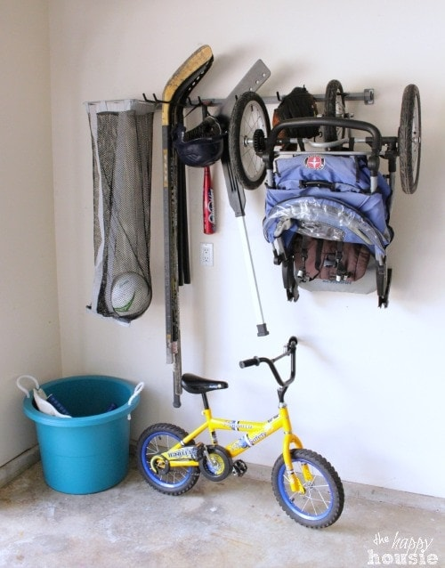 Hanging up sports equipment in a garage