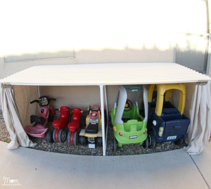 A DIY covered garage for kids' riding toys