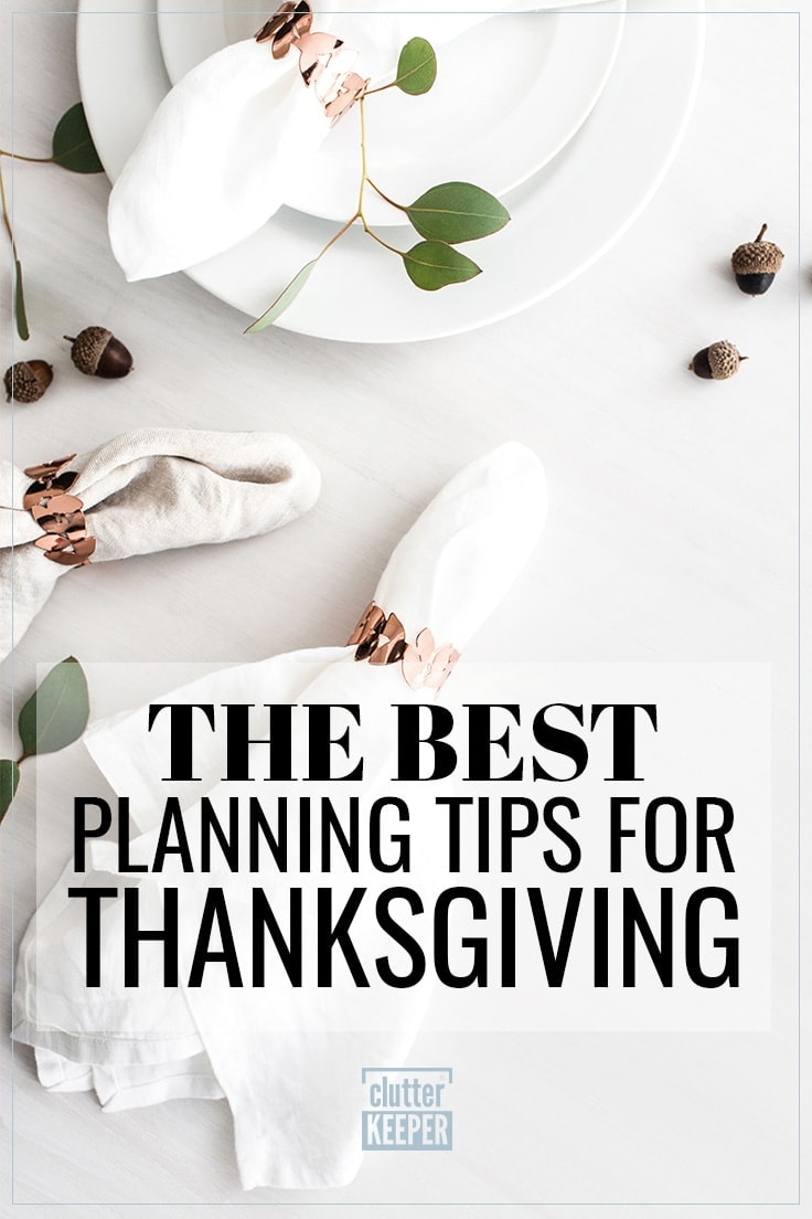The Best Planning Tips for Thanksgiving, napkins with copper napkin rings on a table sprinkled with acorns