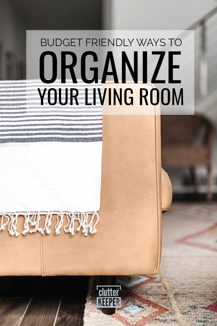 Budget Friendly Ways to Organize Your Living Room, the back side of a leather couch with a blanket across the back of it.