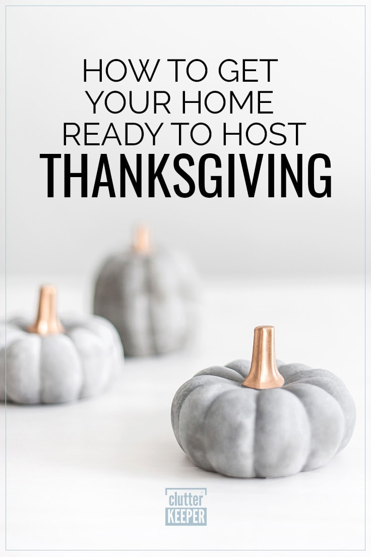 How to Get Your Home Ready to Host Thanksgiving, image of gray decorative pumpkins with gold stems