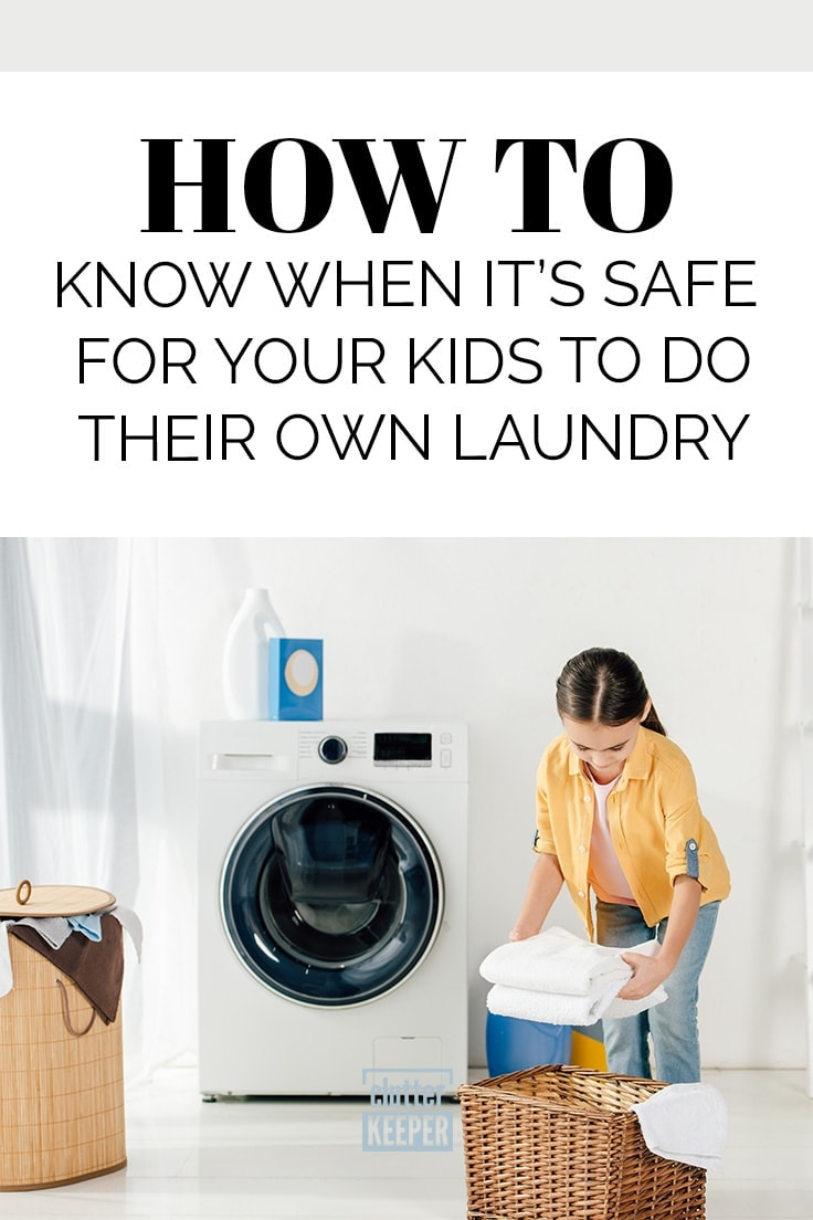 How to Know When It's Safe for Your Kids to Do Their Own Laundry, child putting folded towels in a wicker laundry basket near a washing machine