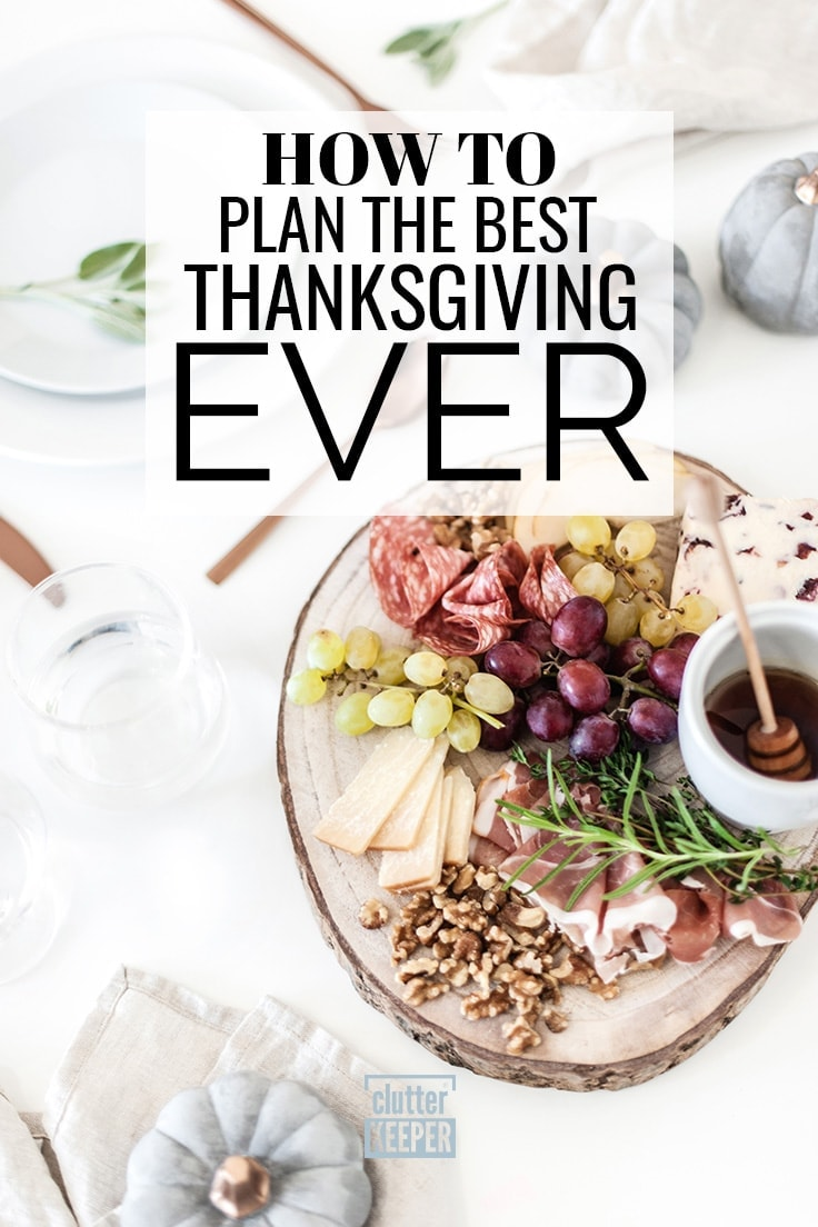 How to Plan the Best Thanksgiving Ever, overhead image of a charcuterie filled with grapes, cheeses, nuts and sliced meats as an appetizer for Thanksgiving dinner