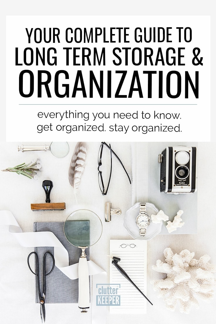 Your Complete Guide to Long Term Storage and Organization, Everything you need to know. Get organized. Stay organized. Overhead image of a vintage Kodak camera, an heirloom watch, reading glasses, scissors, magnifying glasses, a notepad, a feather, a metal clip and other collectibles, souvenirs and keepsakes ready for long term storage