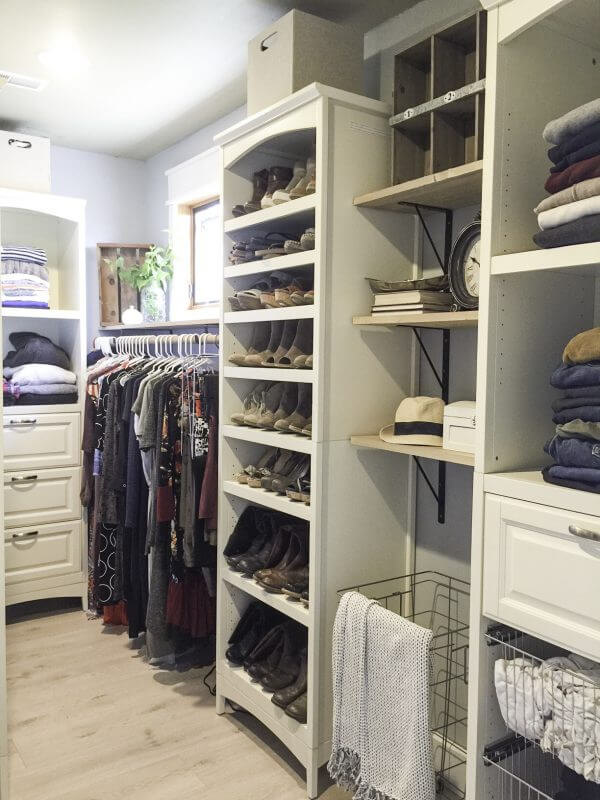 An organized farmhouse style walk in closet.