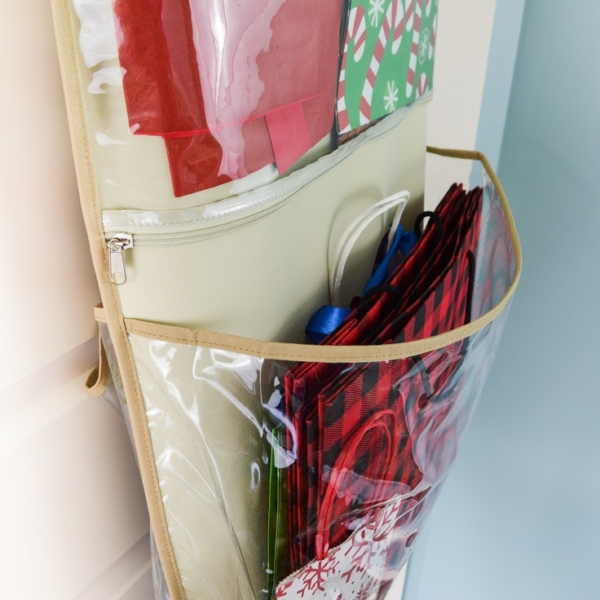 Close up of a pocket in a hanging organizer filled with holiday gift bags