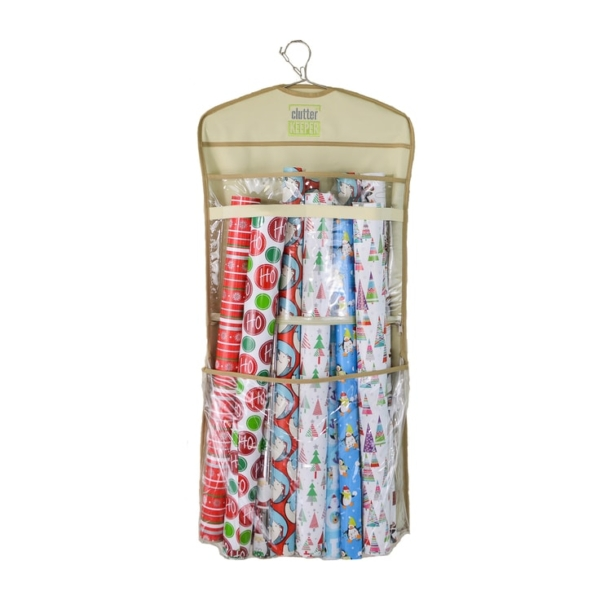 A Clutter Keeper hanging organizer filled with Christmas wrapping paper rolls