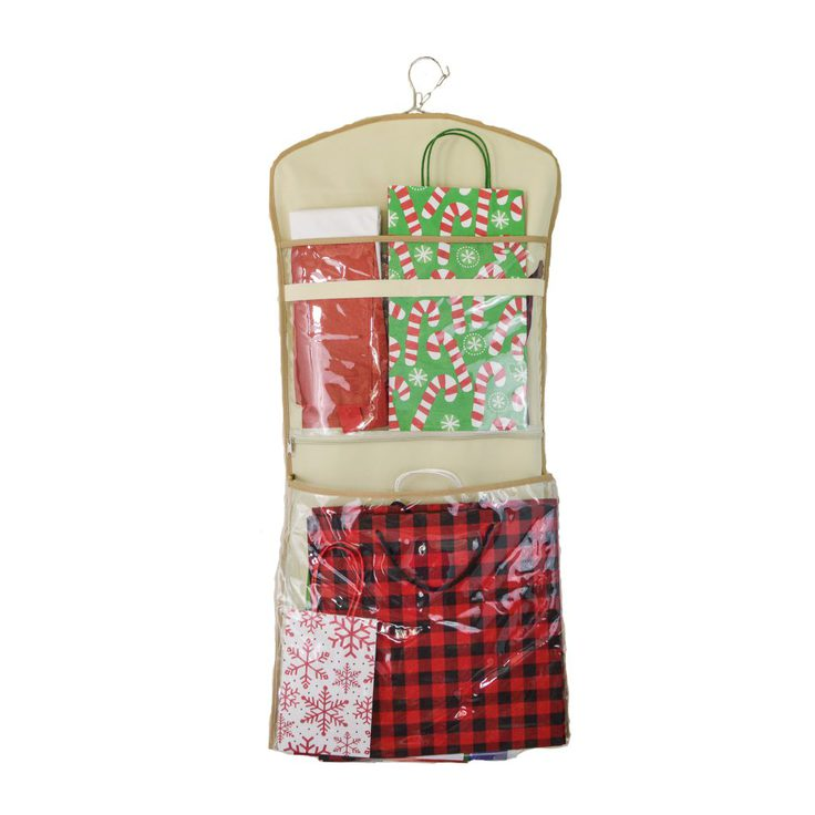 A Clutter Keeper hanging organizer being used as Christmas gift bag storage.
