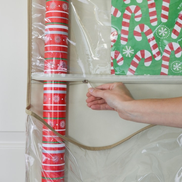 Close up of the Clutter Keeper® Smart Pocket System. A zipper opens up to allow long rolls of wrapping paper to slide through.